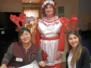 mrs claus virginia oickle with reindeer helpers gina shin and stephanie bueno
